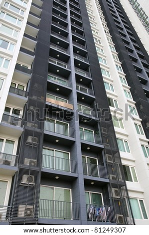Abstract Architectural Detail of a High Rise Condo Building - stock photo