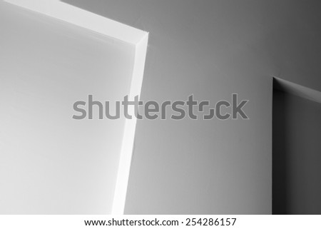 Abstract architecture fragment, white wall with shadow and decoration element  - stock photo