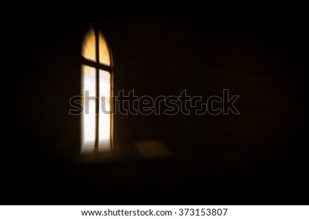 Abstract artistic dark blur glowing window with a cross in the darkness, with copy space for text - stock photo