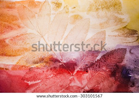 Abstract artistic watercolor background with autumn leaf prints on paper - stock photo