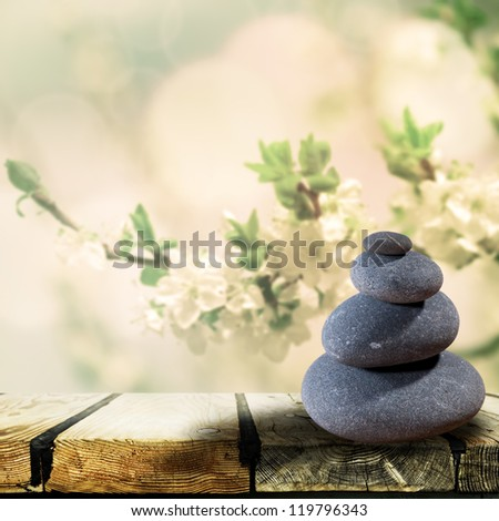 Abstract asian backgrounds with pebble over wooden desk - stock photo