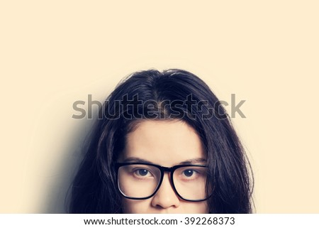 Abstract Asian woman wearing glasses looking to camera isolated on white background.vintage style filter. - stock photo