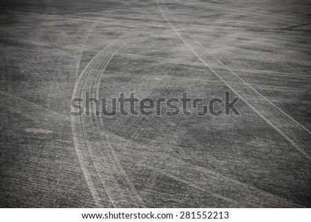 Abstract asphalt road background with crossing of tires tracks. - stock photo