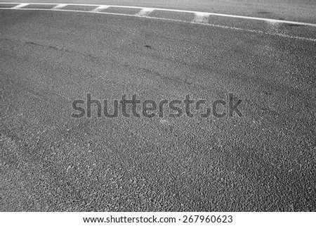 Abstract asphalt road fragment with marking lines, automotive transportation background - stock photo
