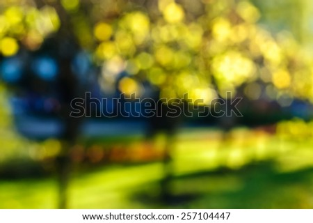 abstract autumn background blurred by bokeh - stock photo