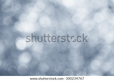 Abstract background blue bokeh circles for Christmas - stock photo