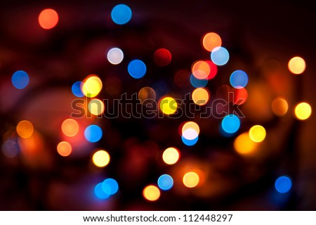 Abstract background - blurred colorful circles bokeh of Christmaslight against dark background - stock photo