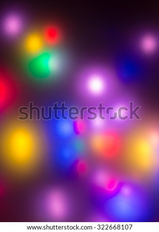 Abstract background bright soft focus colorful lights on black - stock photo