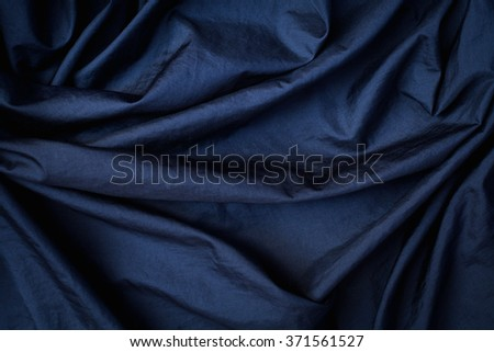 abstract background cloth or liquid wave or wavy folds of grunge texture  - stock photo