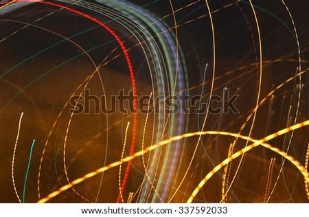 Abstract background, color lights into motion over dark - stock photo