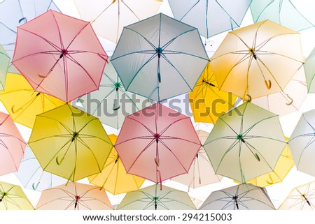 Abstract background colorful umbrella street decoration in the wind motion - pastel effect - stock photo