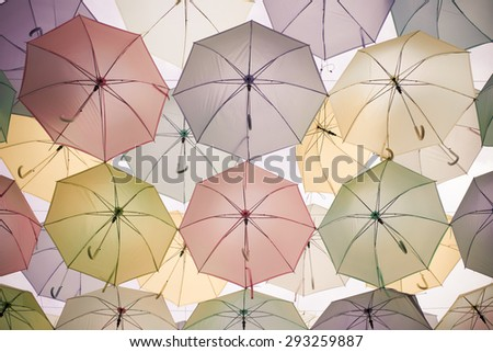 Abstract background colorful umbrella street decoration in the wind motion - vintage effect - stock photo