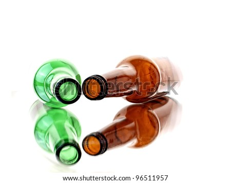 Abstract background design made up of different colored  empty  beer bottles. - stock photo