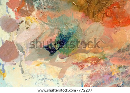 abstract background from a well used paint palette - stock photo