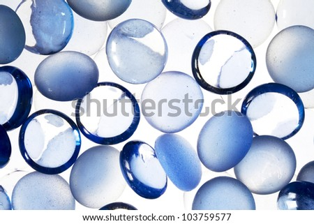 Abstract background from blue glass pebbles - stock photo