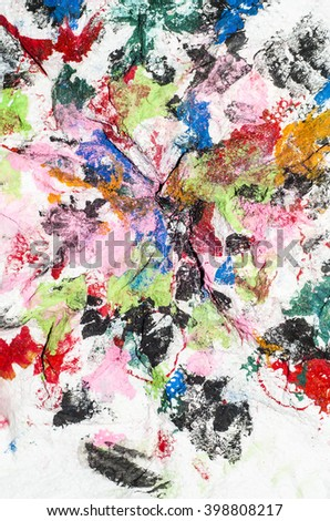 Abstract background from discarded kitchen roll paper used for cleaning paint brushes or checking color tones during mixing / Abstract background / After painting the paper are recycled for future use - stock photo