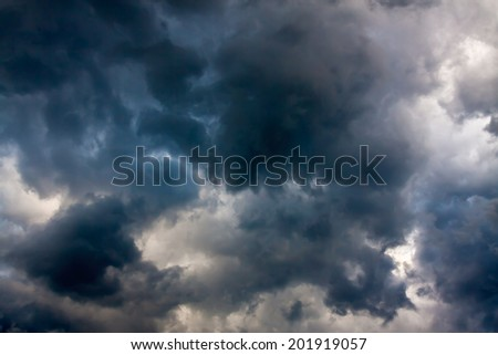 abstract background from the sky and dark storm clouds - stock photo