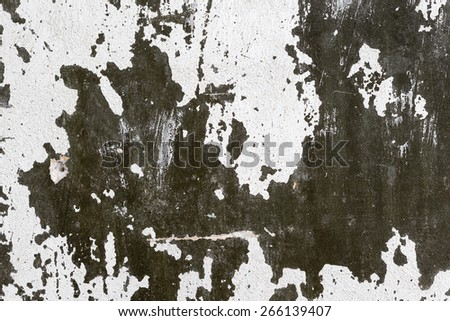 Abstract background gloomy concrete wall, casually painted dark green paint, weathered with cracks and scratches in the wall hammered a rusty nail. Requires urgent repairs. Great background or texture - stock photo