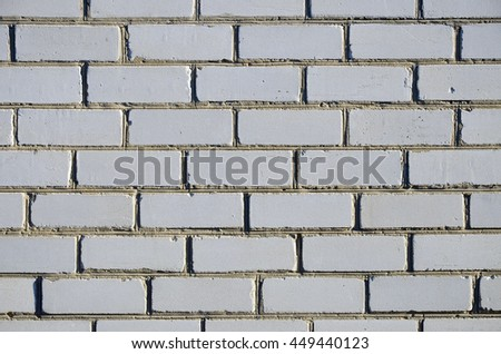Abstract background grunge of a fragment of the blank clean wall from rectangular white silicate brick. Texture seven complete series of brick masonry. - stock photo