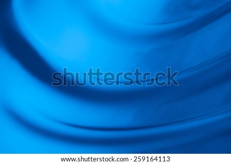 abstract background luxury cloth or liquid wave or wavy folds of grunge blue silk texture satin velvet material or luxurious - stock photo