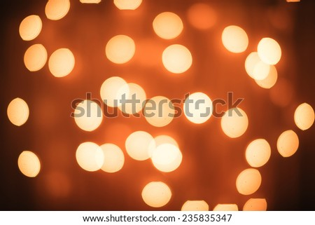Abstract background of blurred lights with bokeh effect - stock photo