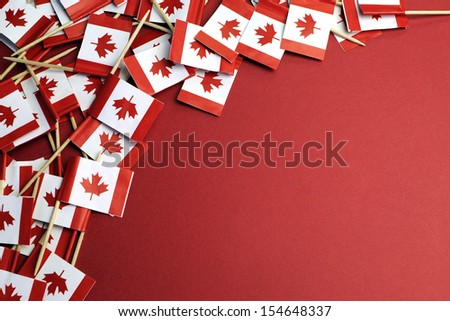 Abstract background of Canada red and white Maple Leaf national toothpick flags for travel, national emblem, food background, or public holiday event, with copy space for your text here. - stock photo