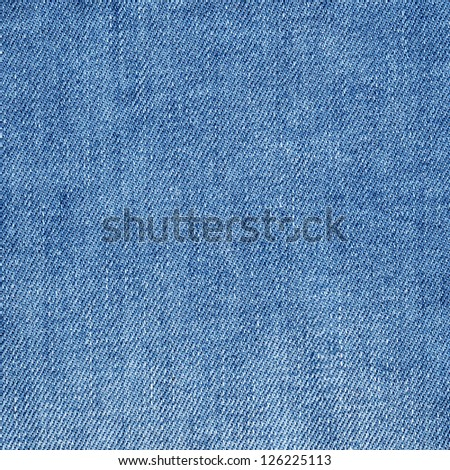 Abstract background of closeup denim textile - stock photo