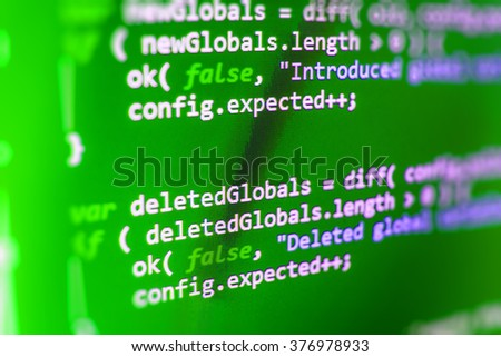 Abstract background of computer source code. Web developer programmer monitor screen display. Shallow depth of field, selective focus effect. All code and text written and created entirely by myself. - stock photo