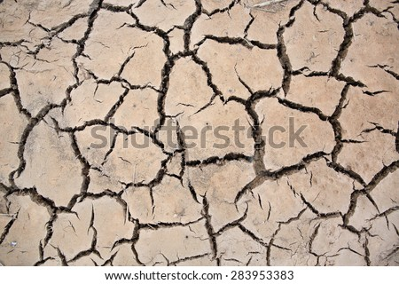 abstract background of cracked clay ground - stock photo