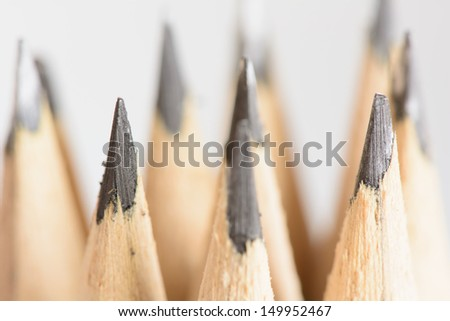 Abstract background of pencils with extremely shallow dof. Selective focus limited to front pencil.  - stock photo