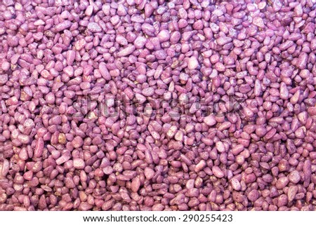 Abstract background of purple pebbles - stock photo
