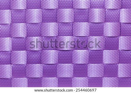 abstract background of purple plastic woven texture - stock photo