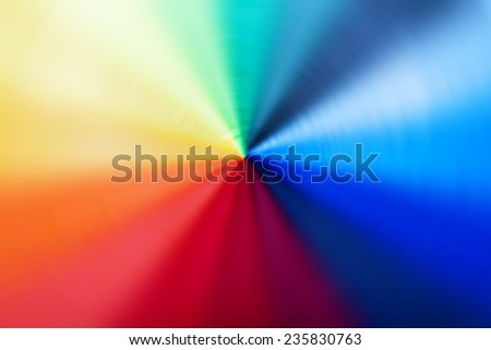 Abstract background of spin circle radial blur in rainbow colors, red, orange, yellow, blue, purple, green, and black  - stock photo