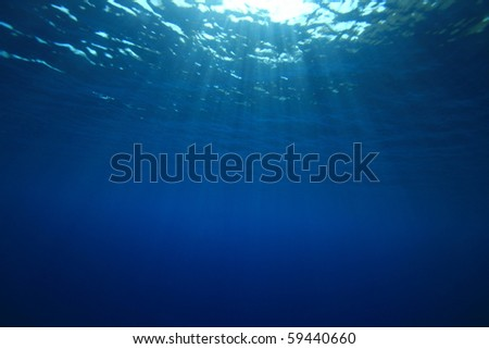 Abstract background of sun rays on the ocean surface - stock photo