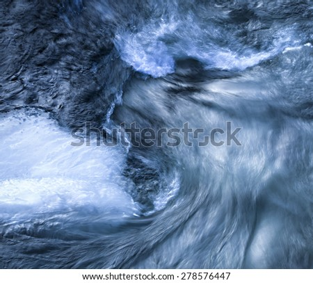 abstract background or texture blue twisting the ice water - stock photo