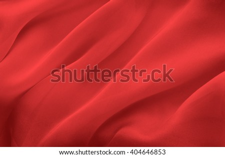 abstract background red fabric folds - stock photo