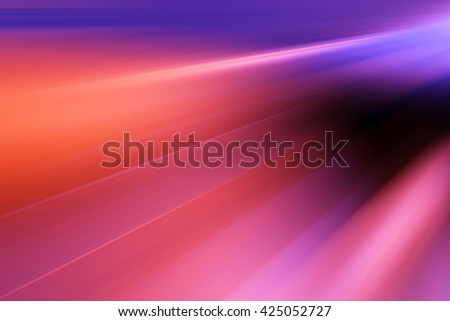 Abstract background representing speed, motion and burst of colors and light in red, purple, pink, orange colors. - stock photo