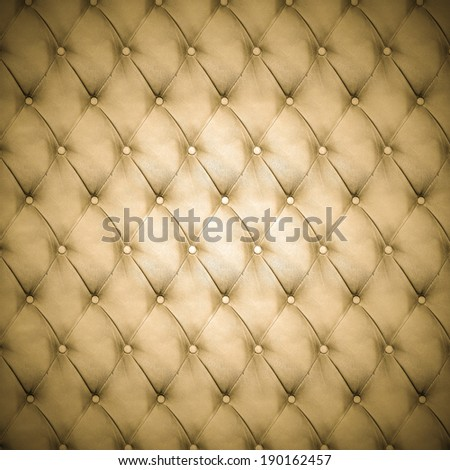 Abstract background texture of an old natural luxury, modern style leather with rhombs. Classic brown, black and dark pink grungy skin of retro wall, door, sofa or studio interior with metal buttons. - stock photo