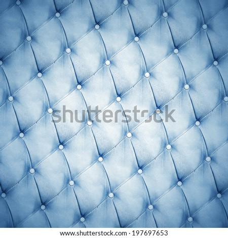 Abstract background texture of an old natural luxury, modern style leather with rhombs. Classic white, black and dark blue grungy skin of retro wall, door, sofa or studio interior with metal buttons. - stock photo