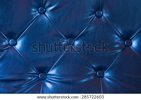 Abstract background texture of an old natural luxury, modern style leather with rhombs. Classic white, light and dark gray grungy skin of retro wall, door, sofa or studio interior with metal buttons. - stock photo