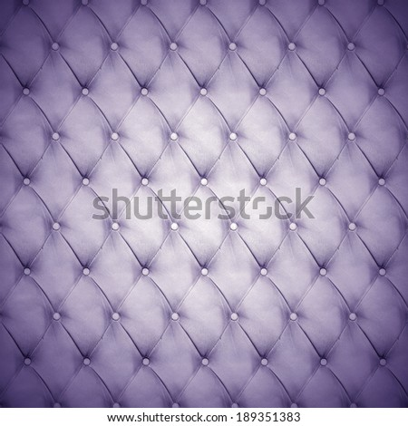 Abstract background texture of an old natural luxury, modern style leather with rhombs Classic blue, violet and purple gray grungy skin of retro wall, door, sofa or studio interior with metal buttons - stock photo