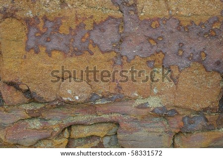 abstract background texture of seashore rock of sandgate - stock photo