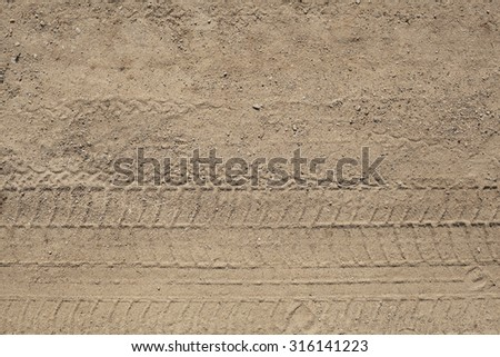 Abstract background - the wheel tracks in the sand - stock photo