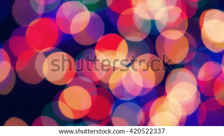 Abstract background with bright festive colored lights - stock photo