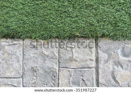 Abstract background with concrete pathway and artificial grass - stock photo