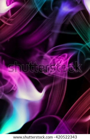 Abstract background with moving colored smoke on black - stock photo