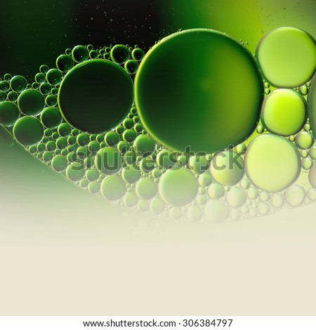 Abstract background with oil drops on water, macro with copyspace. - stock photo