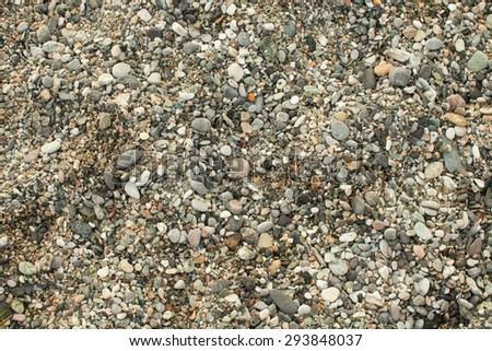 Abstract background with pebbles - round sea stones.Sea stones background. - stock photo