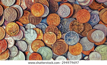 Abstract background with silver and gold colors coins - stock photo