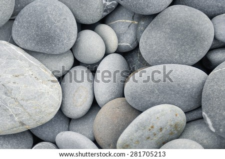 abstract background with tropical pebbles stones - stock photo